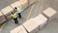 Workers in a large food distribution warehouse