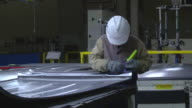 MS ZO Workers inspect sheet metal stampings before welded together to form a minivan / Princeton, Indiana, United States