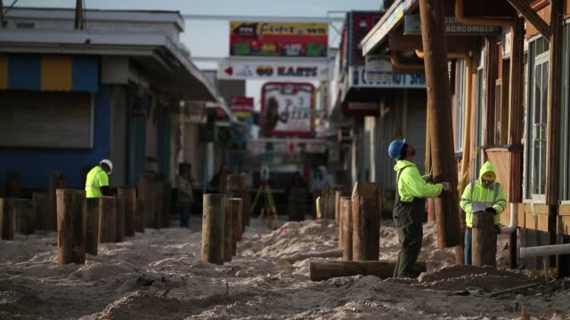 Workers install new pilings for boardwalk Seaside Heights New Jersey February 19 2013 New Jersey Shore Still Heavily Damaged Months After Hurricane...