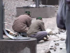 Workers Laying Cobble Stones