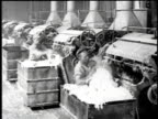 1921 MONTAGE Workers loading and a variety of factory machines processing asbestos fiber / Waukegan, Illinois, United States