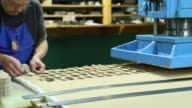 Workers make teddy bears at the Vermont Teddy Bear factory in Shelburne Vermont November 13 2015 Videographer Shiho Fukada Shots An employee uses a...