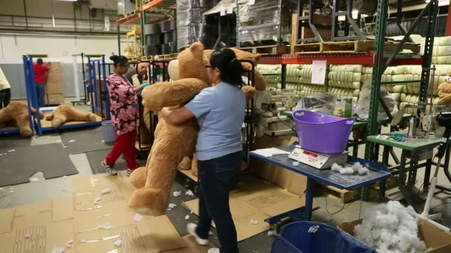 Workers make teddy bears at the Vermont Teddy Bear factory in Shelburne Vermont November 13 2015 Shots An employee grooms the fur of an empty Vermont...