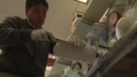 Workers Making A Prosthetic In Lab