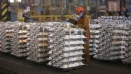 Workers mark stacks of aluminium ingots in preparation for shipping in the foundry at the Sayanogorsk aluminium smelter operated by United Co Rusal...