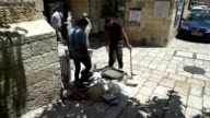 Workers mix and pour concrete in the old city of Jerusalem