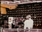 1966 MONTAGE workers operating fuel rods at a reactor / Hanford, Washington, United States