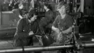 B/W MONTAGE Workers operating machinery in World War II munitions factory / England, United Kingdom