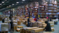 WS T/L Workers preparing boxes for shipment in busy warehouse / LeBec, California, United States