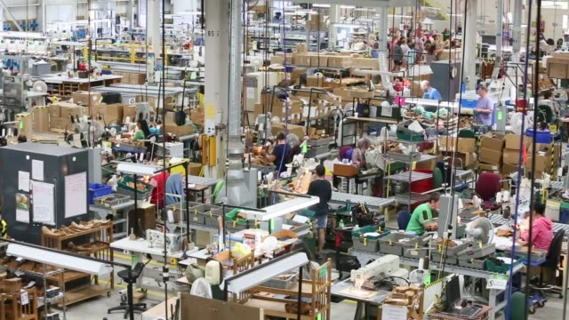 Workers produce boots on the floor of the LL Bean Inc manufacturing facility in Brunswick Maine US on Wednesday Sept 9 2015 Shots Wide shot of the...