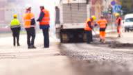 Workers repairing road