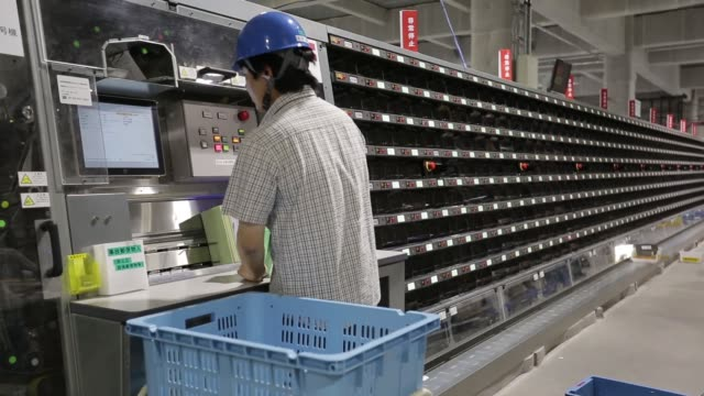 Workers sort mails at a distribution center inside Japan Post Co's Tokyo Northern post office in Wako Saitama Prefecture Japan on Friday Oct 23 A...