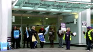 University College Hospital picket line ENGLAND London University College Hospital EXT Striking NHS workers holding placards and flags and chanting...