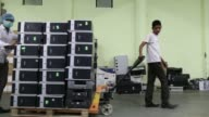 Workers transport refurbished computers at the Attero Recycling Pvt facility in the Raipur industrial area of Bhagwanpur in Roorkee Uttarkhand India...