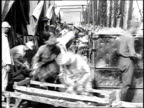 MS workers unloading bread loaves from large ovens into carrying trays / France