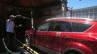 Workers use brushes to clean a car at Ducky's Car Wash on July 29 2015 in San Mateo California As California endures its fourth year of severe...