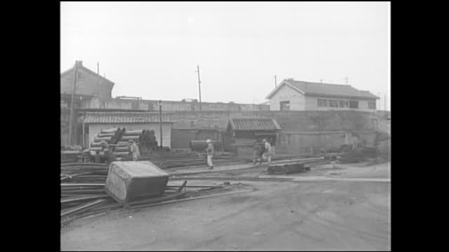 Workers walk around the Chikuho Coal Field in Fukuoka, Japan.