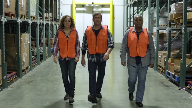 Workers walking in a warehouse