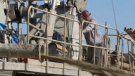 WS Workers with Arthur Orum Well Drilling operate a drilling rig while drilling a well at a farm on April 29 2014 near Mendota California As the...