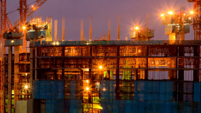 Working at Construction Site from Dusk to Night Time Lapse