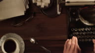 DS Working in an office on old typewriter