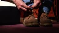 Working man ties boots