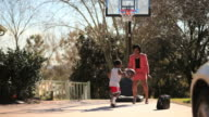 Working Mother Playing Basketball with Her Son
