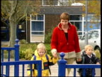 Survey reveals discontent EVENING NEWS HARRY SMITH ENGLAND EXT Mother leaving school with her son and daughter CMS Mother and two girls with...