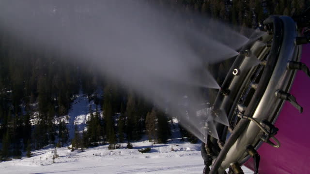 CU Working Snow Cannon in the Dolomites Mountains