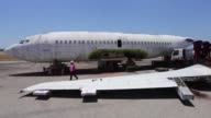 Workmen began disassembling in Brazil an old Lufthansa airplane hijacked by a pro Palestinian militant group in 1977 before sending the aircraft to...