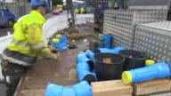 MS Workmen keeping properly water pipes / Konz, Rhineland-Palatinate, Germany