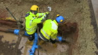 MS Workmen repairing water pipes in street / Konz, Rhineland-Palatinate, Germany