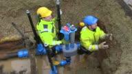 MS Workmen repairing water pipes in street / Konz, Rhineland-Palatinate, Germany