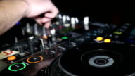 DJ works for the mixing desk