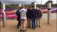 Athletes hit by vomiting bug ENGLAND London London Stadium Isaac Makwala sitting on bus London Stadium seen through window People disembarking bus...