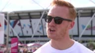 Great Britain win two more relay medals Greg Rutherford interview SOT Wide shot Olympic stadium Various shots people clearing up after World...