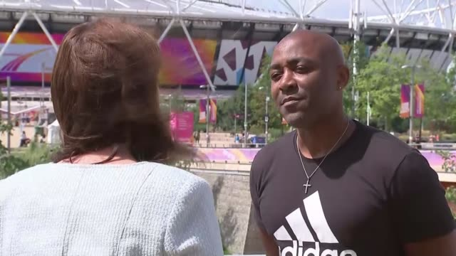 Justin Gatlin jeered by crowds after winning 100m final DAY Darren Campbell setup shot and interview SOT re use of performanceenhancing drugs in...