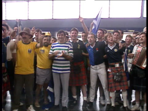 Scottish fans / Ticket touts ITALY Turin Scottish pipers march along People looking from balconies Large crowd applauding Scottish fans amp Brazilian...