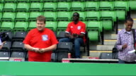 Dizzee Rascal and James Corden record 'Shout For England' World Cup song Three men kicking football about on pitch / James Corden and Dizzee Rascal...