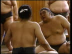 Day's matches ITN Sumo wrestlers wrestling in ring Sapporo England captain David Beckham along at England training session Sven Goran Eriksson press...