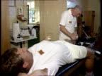 England team 1700 Same as 2045 AUSTRALIA Sydney MS England physiotherapist Laurie Brown treating Ian Botham as Derek Pringle looks on CMS Brown BV...