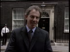 Gascoigne ITN Downing Street PM Tony Blair MP standing posing with Marks Spencer chairman Sir Richard Greenbury a group of children Tony Blair MP...
