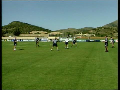 Gascoigne SPAIN La Manga England players in training Alan Shearer jumping to head ball Paul Merson kicking ball along Les Ferdinand running along