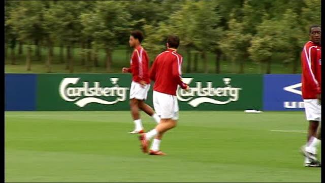 England training session Gareth Barry kicking ball / Focus shots on Rio Ferdinand Glen Johnson Wayne Rooney / Wide view England team training / Fabio...