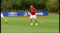 England training session Players along jogging and kicking football including Ferdinand with Jimmy Bullard / Focus shots on David Beckham Jimmy...