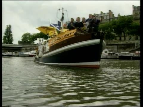 Scottish fans in Paris LIB GVs Scottish fans singing on boat as fan plays banjo