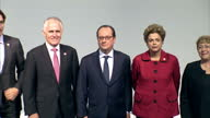 World leaders attend COP21 Shows inteiror shots world leaders gathered on stage with Francois Hollande Dilma Rousseff standing together alongside...