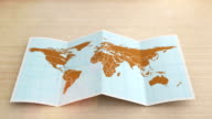 World map folds out on desk. Three in one.