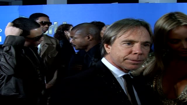Celebrity red carpet arrivals and interviews / Winners room interviews Tommy Hilfiger and Dee Ocleppo interview on red carpet SOT On red carpet...