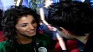 Celebrity red carpet arrivals and interviews / Winners room interviews General view of Katie Melua wearing green tshirt and black necklaces speaking...